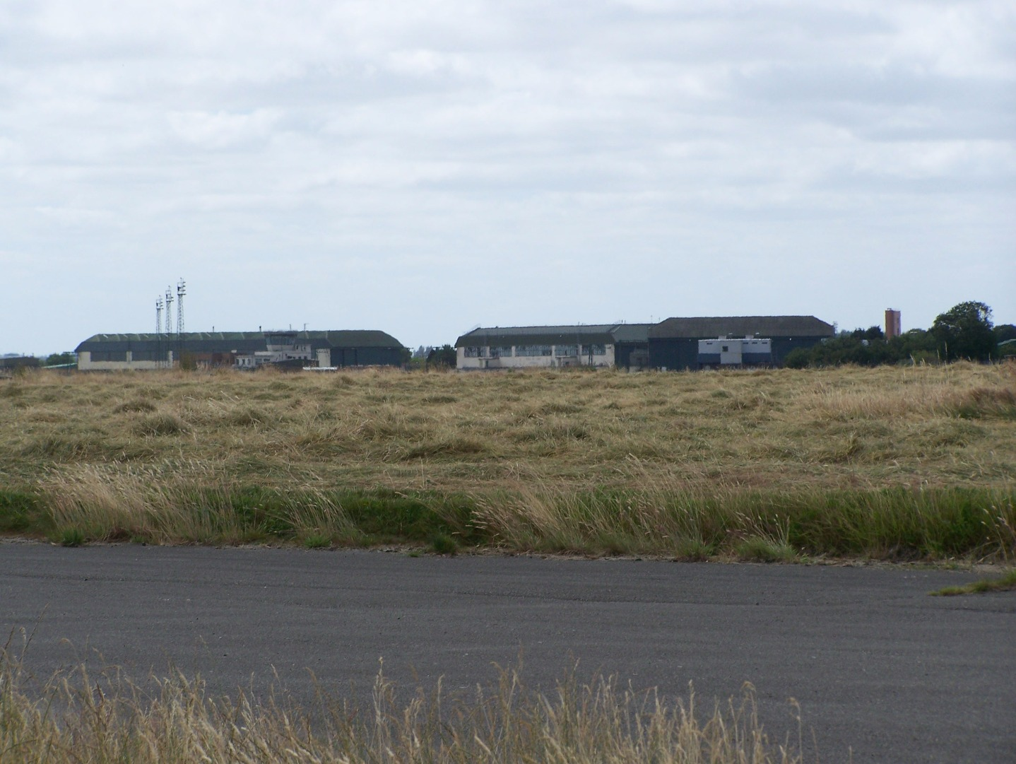Looking approximately south-west on north-east side of airfield towards control tower and Type C1 hangars 14:7:06.JPG