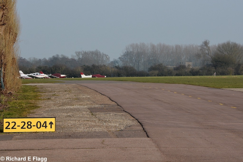 007Taxiway at the north of the airfield. Looking east from near the flying club - 12 March 2016.png